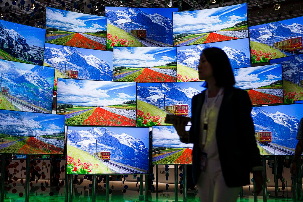 A visitor passing the display wall from Samsung at the 2016 IFA