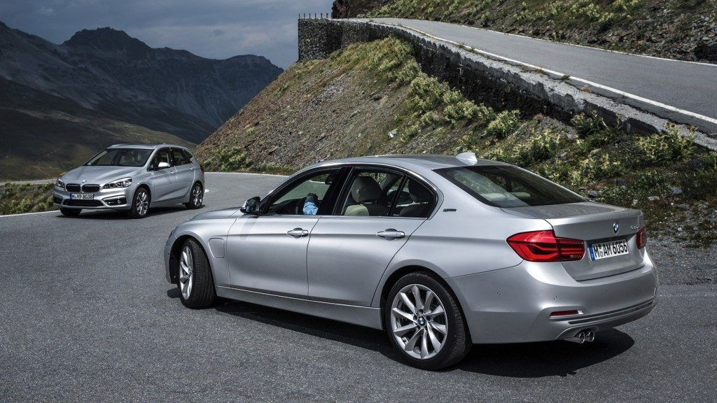 The BMW 330e plug-in hybrid in the foreground