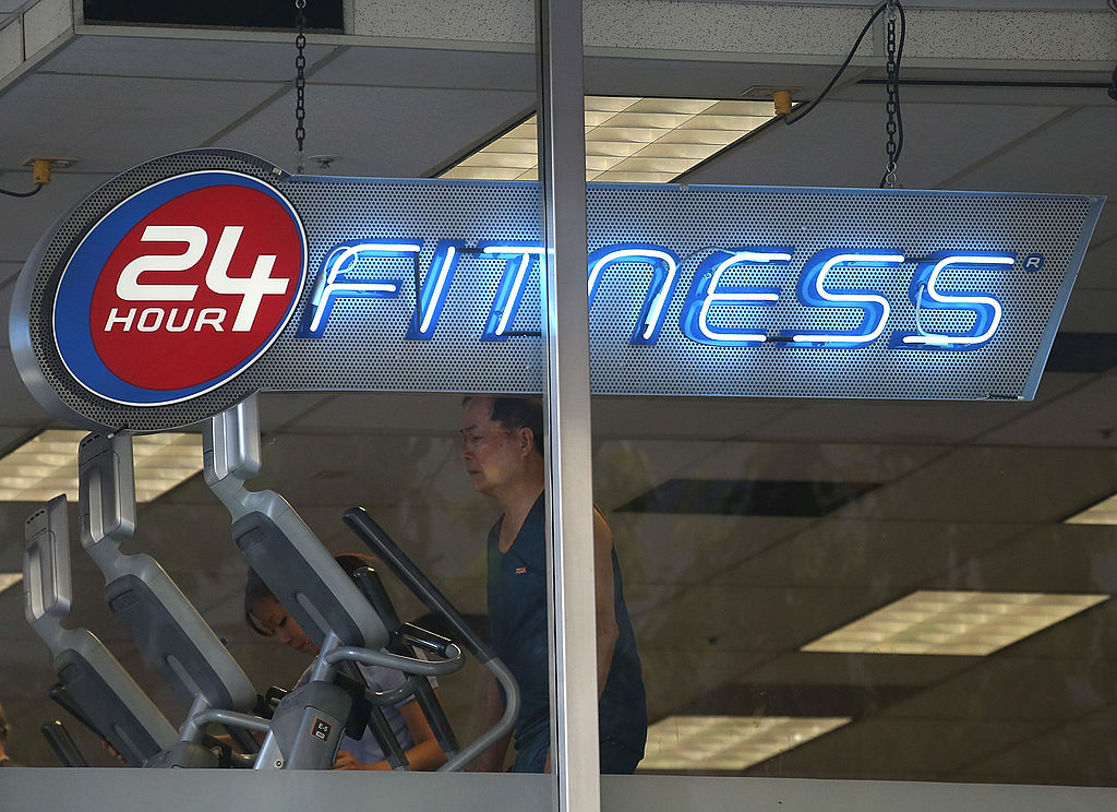 A man getting in one of his workouts at a 24 Hour Fitness center