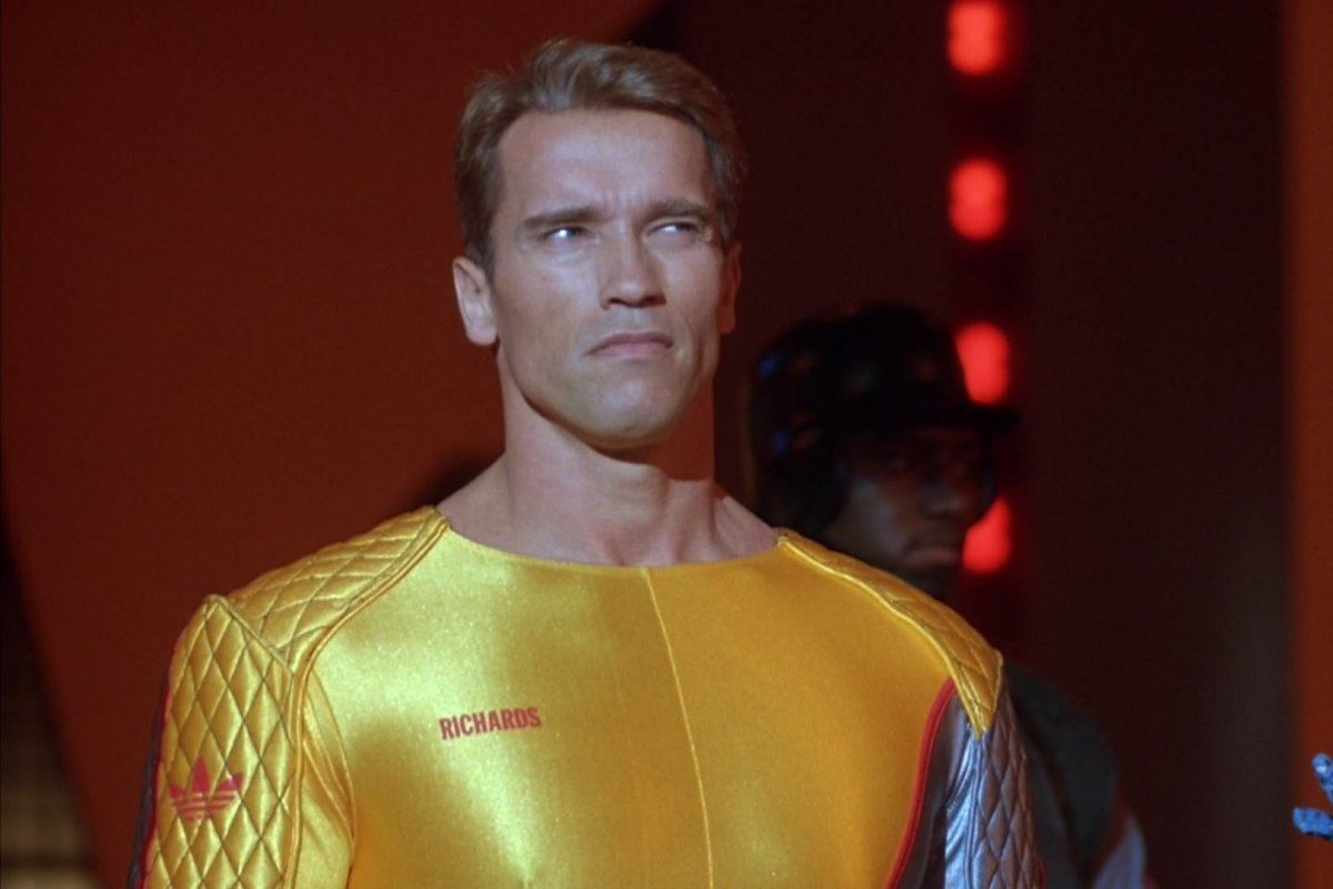 Arnold Schwarzenegger wears a yellow suit in The Running Man