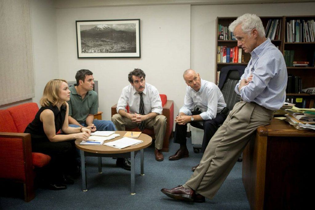 Journalists sitting in a room together talking in Spotlight