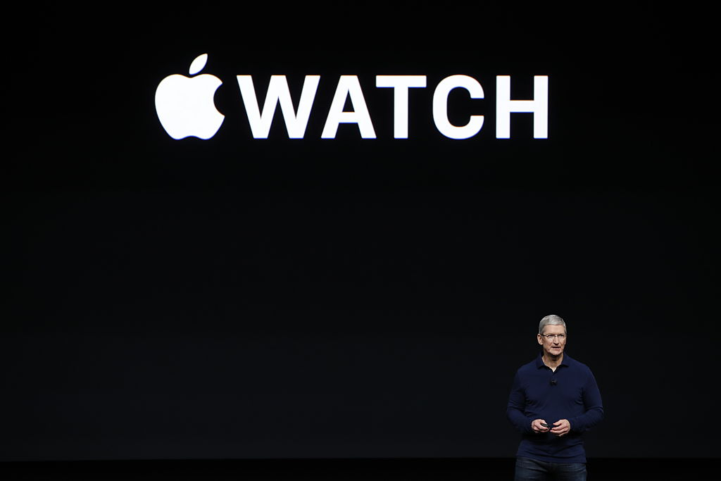 Apple CEO Tim Cook speaks on stage during a launch event for the iPhone 7 and Apple Watch 2