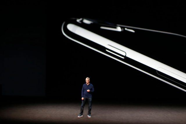 Apple CEO Tim Cook speaks on stage about iPhone 7 features