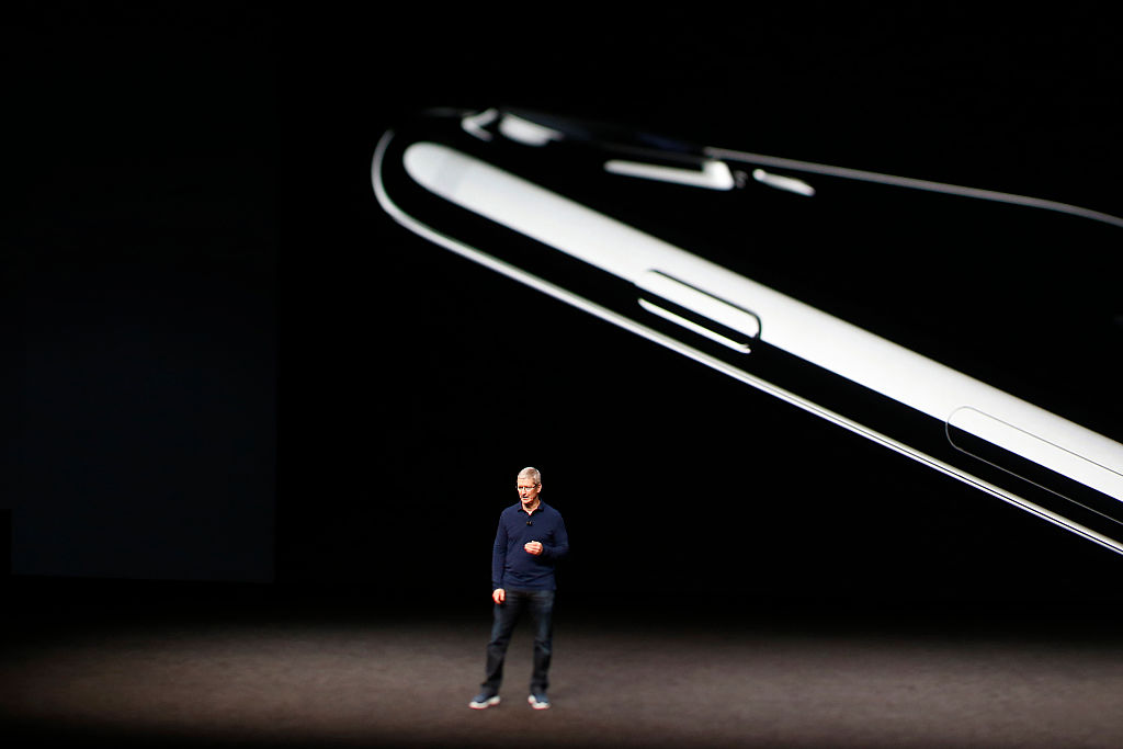 Apple CEO Tim Cook speaks on stage during a launch event