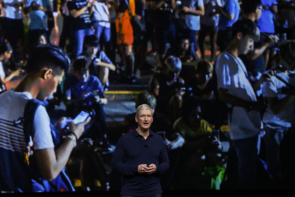 Apple CEO Tim Cook speaks on stage 7 during a launch event