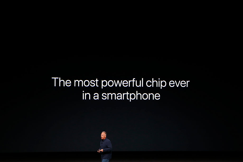 Apple Senior Vice President Phil Schiller speaks on stage during a launch event