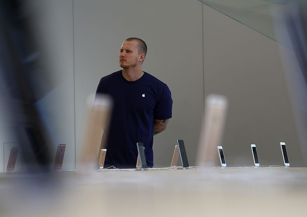 Apple iPhones are displayed during a press preview of the new Apple Store flagship