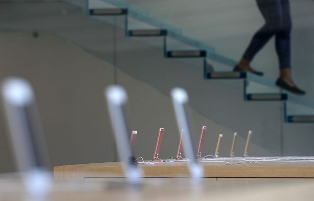 iPhones are displayed during a press preview of the new flagship Apple Store