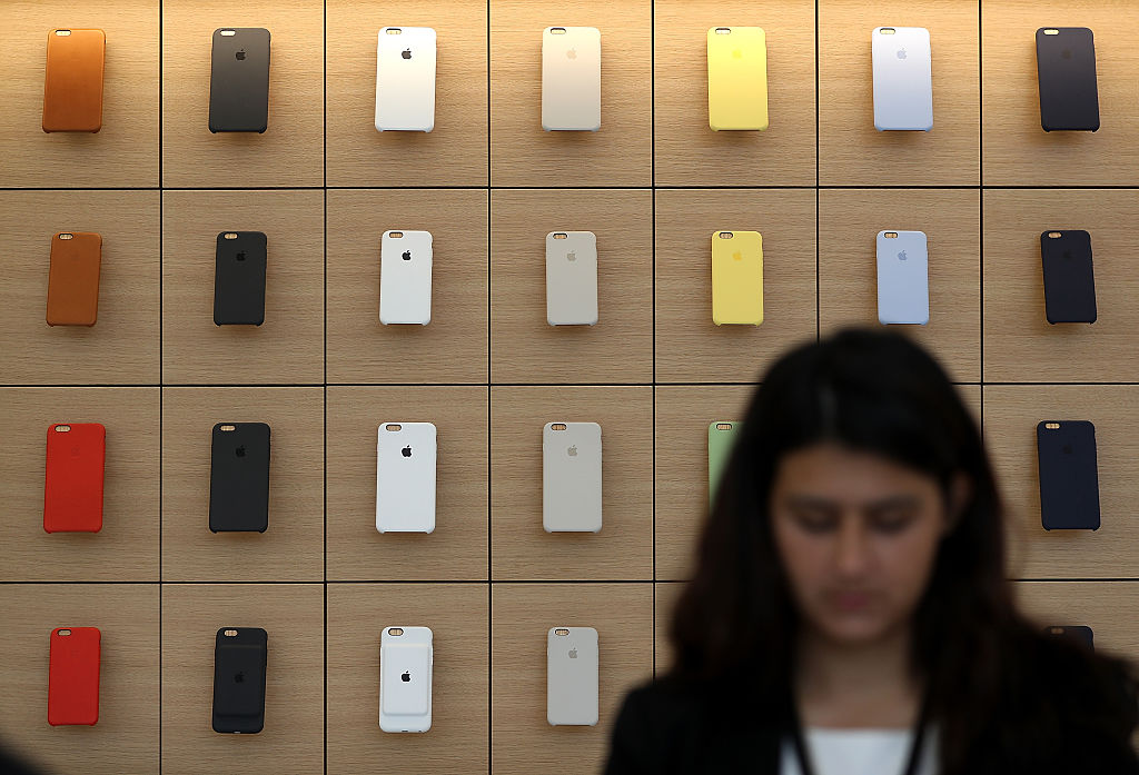 iPhone covers are displayed during a press preview of the new flagship Apple Store