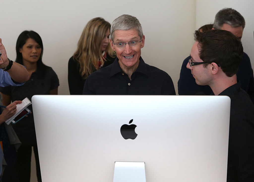 Apple CEO Tim Cook looks at the new 27 inch iMac with 5K retina display