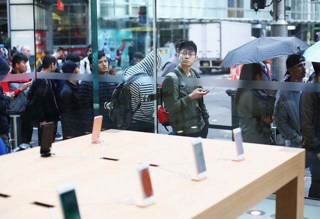 Crowds wait in anticipation for the release of the iPhone 7 at Apple Store