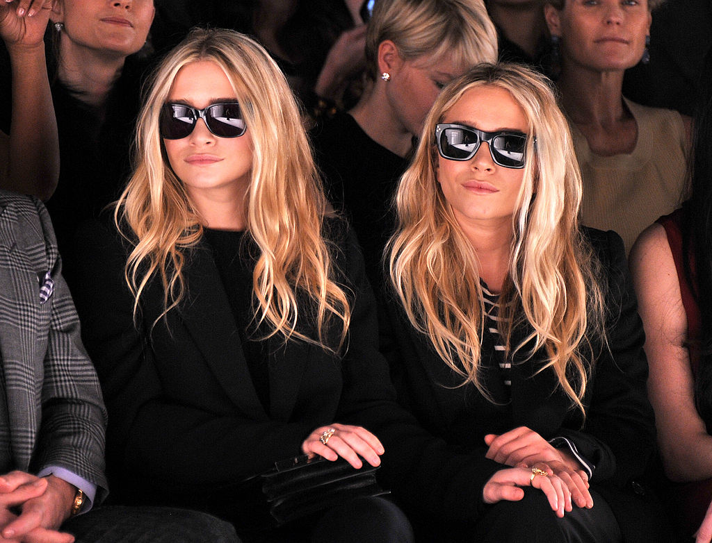 Ashley Olsen and Mary-Kate Olsen attend the J. Mendel Fall 2012 fashion show