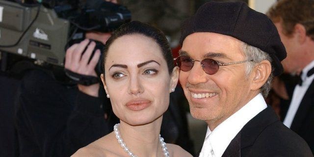 Angelina Jolie and Billy-Bob Thornton pose for photos on a red carpet.
