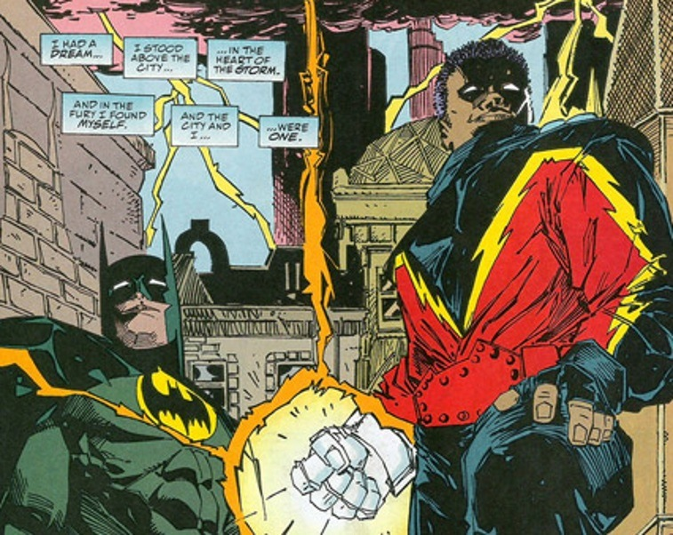 Comic book drawing of Black Lightning and Batman standing together in an alley.