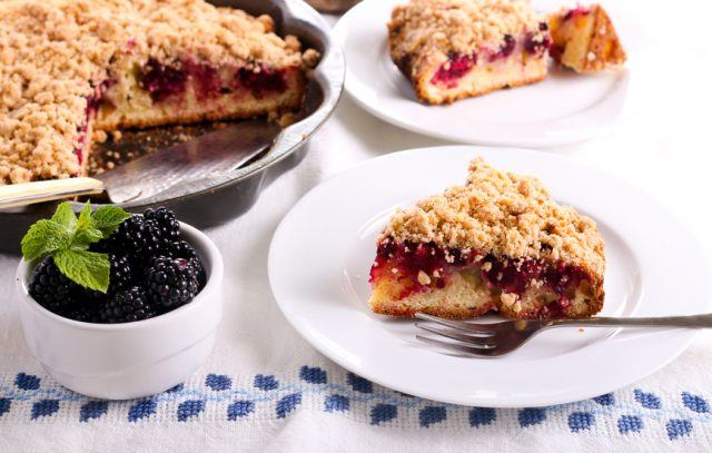 Blackberry crumble topping cake sliced