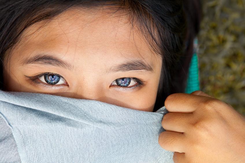 Blue eyes of asian girl