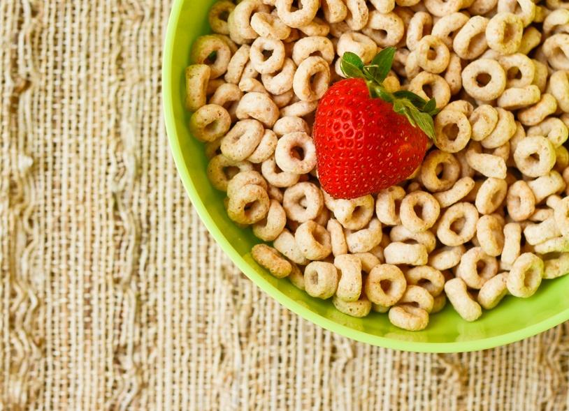 honey nut cheerio with a single strawberrys