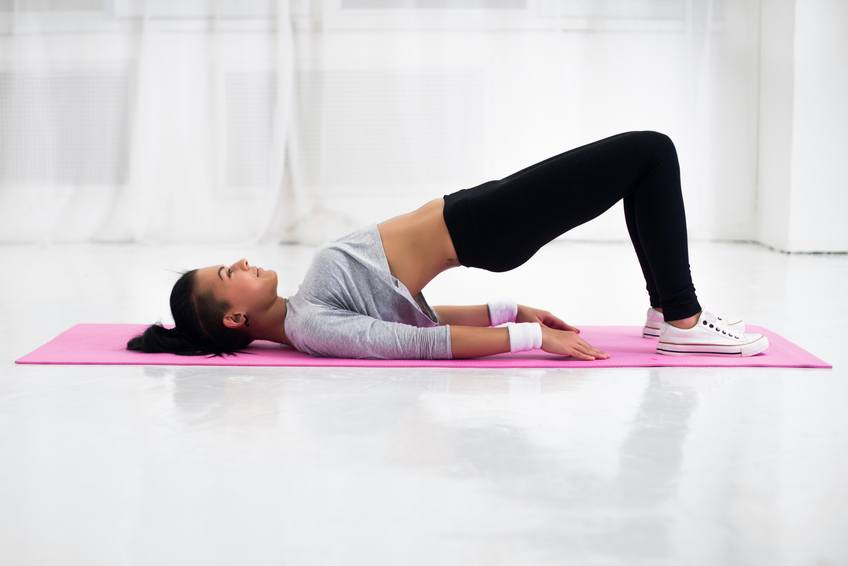 woman doing warming up exercise for spine, backbend