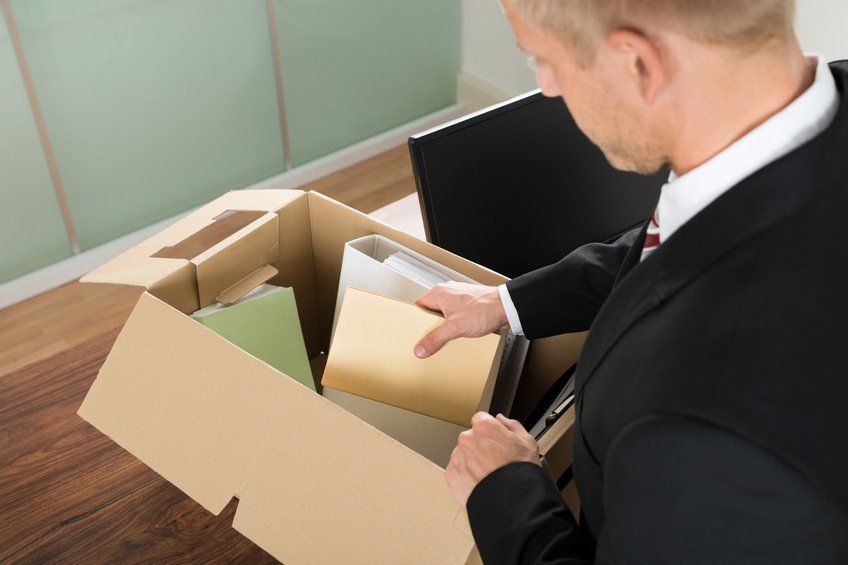 Businessman Packing Files