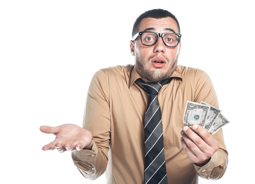 Displeased and confused man holding cash