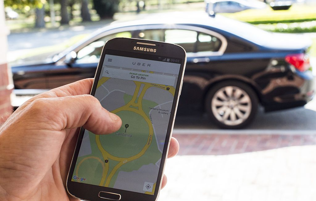 An Uber passenger uses the UberX app
