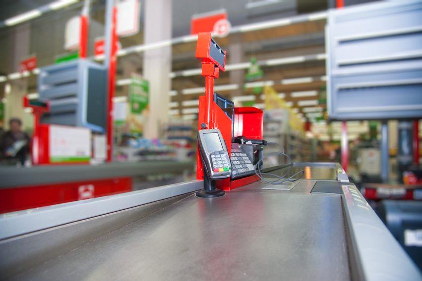 Empty cash desk with payment terminal