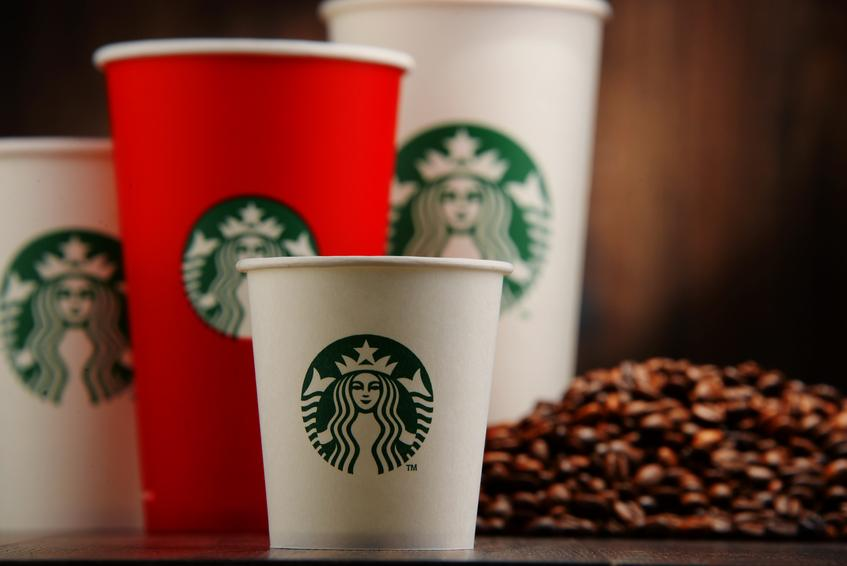 cup of Starbucks coffee and beans