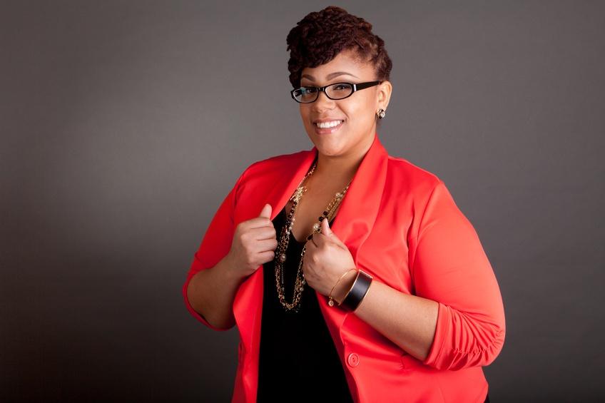 Plus size black woman wearing glasses
