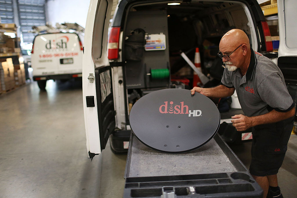 Alberto Rodriguez a Dish Network technician restocks his truck on June 4, 2015 in Miami, Florida