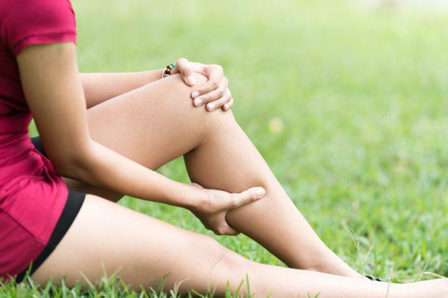 Leg Pain In A Woman on grass
