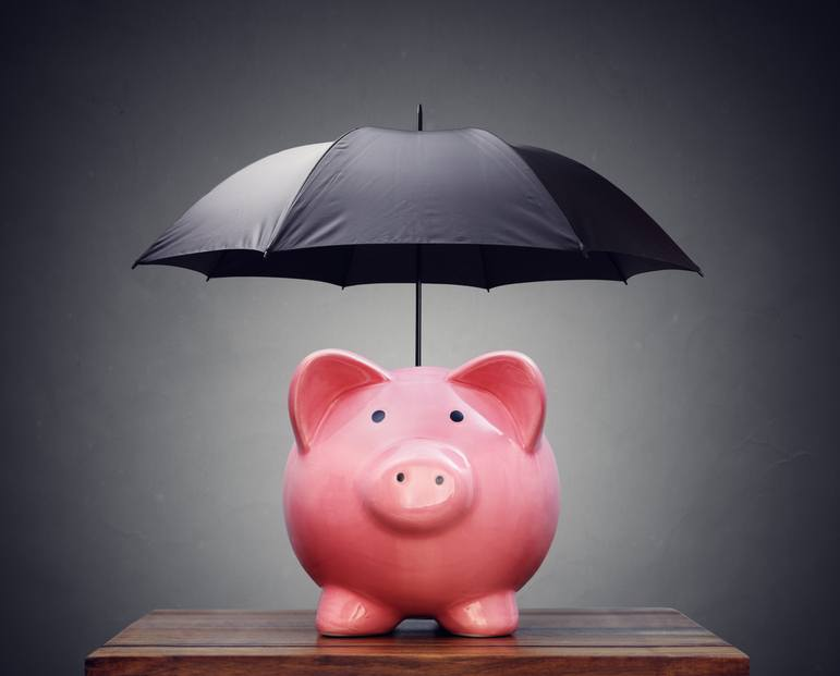 Piggy bank with umbrella concept