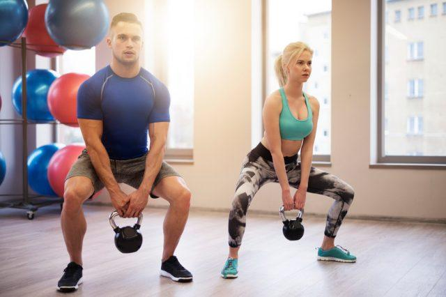 Fit couple lifting heavy kettles