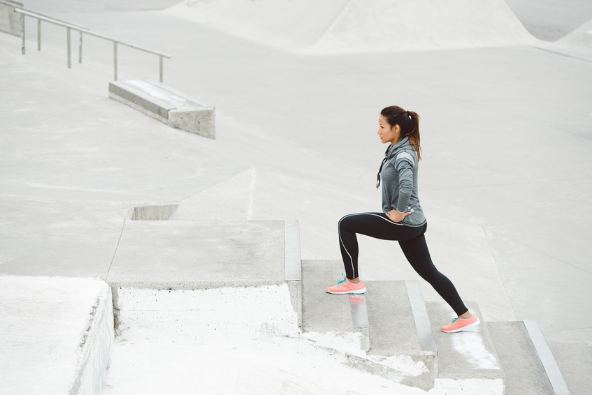 Leg lunges exercise on stairs