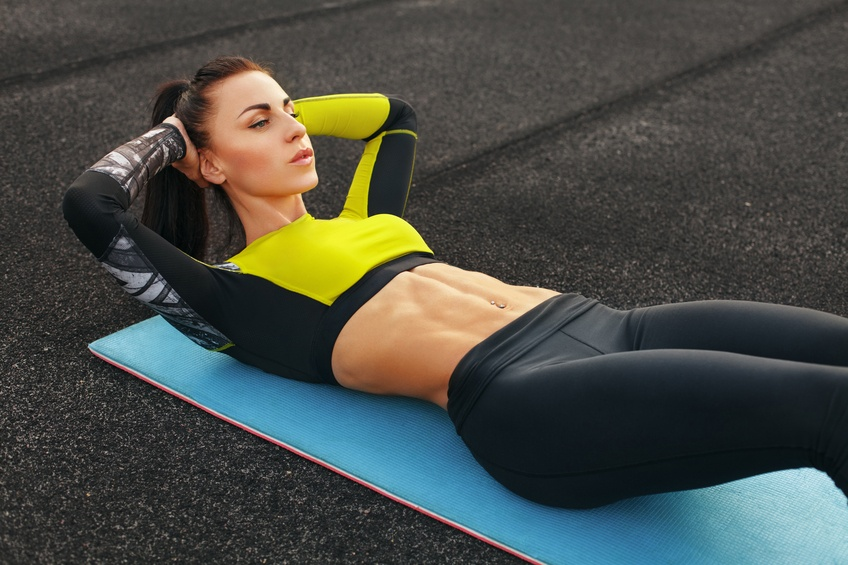 Fitness woman doing sit ups