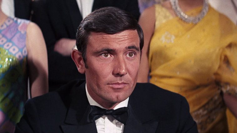 George Lazenby sits in a tux as James Bond as On Her Majesty's Secret Service