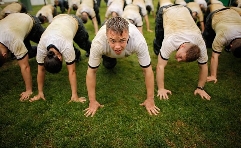 Members of the United States Naval Academy freshman class getting fit and building mental toughness during physical training