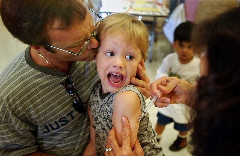 A boy gets a Measles vaccination, stopping a deadly disease in its tracks