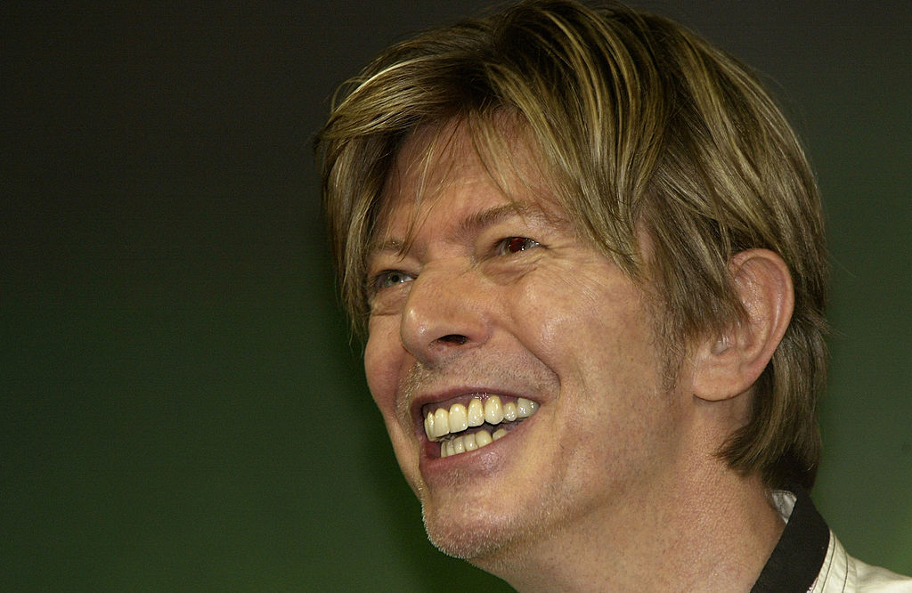 David Bowie smiles as he meets fans