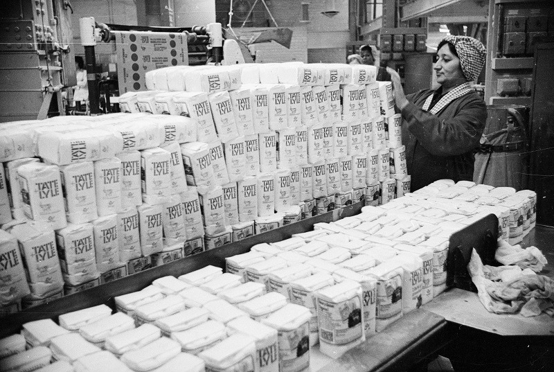 Hundreds of bags of sugar in a warehouse