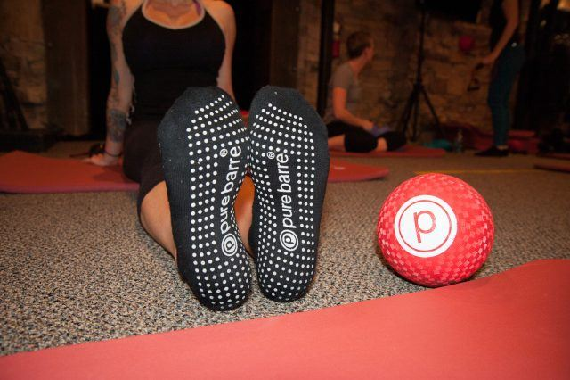 Pure Barre socks and red ball