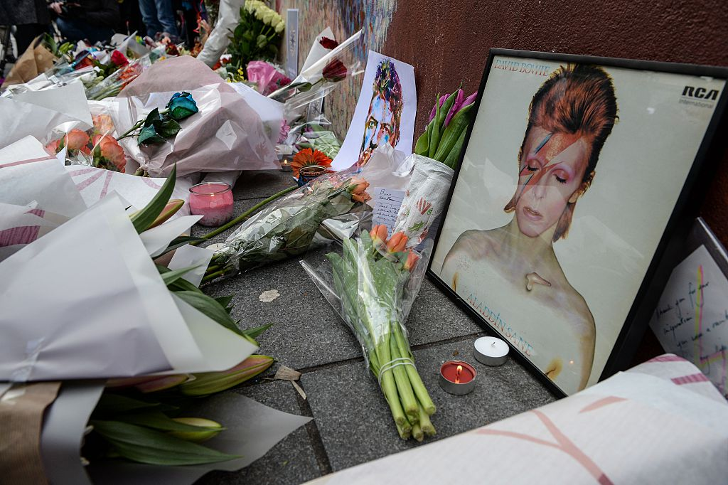 Tributes to David Bowie's memorial in the form of flowers and photos