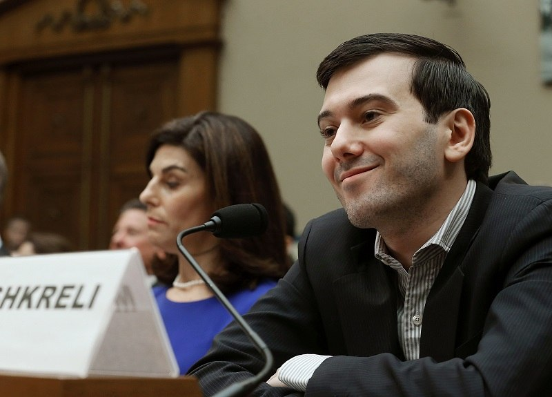 WASHINGTON, DC - FEBRUARY 04: Martin Shkreli, former CEO of Turing Pharmaceuticals LLC., smiles while flanked by Nancy Retzlaff, chief commercial officer for Turing Pharmaceuticals LLC., during a House Oversight and Government Reform Committee hearing on Capitol Hill, February 4, 2016 in Washington, DC. Shkreli invoked his 5th Amendment right not to testify to the committee that is examining the prescription drug market. (Photo by Mark Wilson/Getty Images)