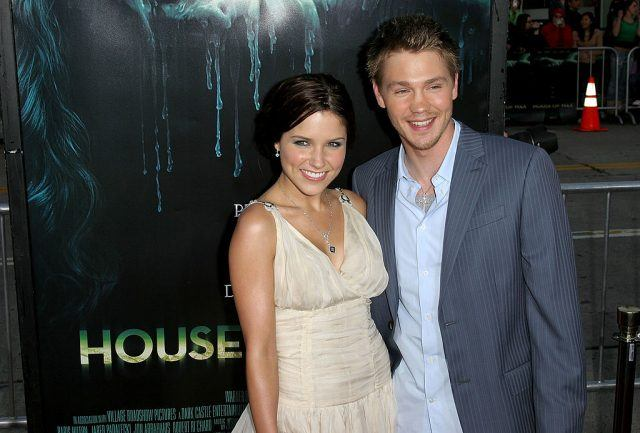 Chad Michael Murray and Sophia Bush smile and look at the camera on the red carpet for the premiere of House of Wax