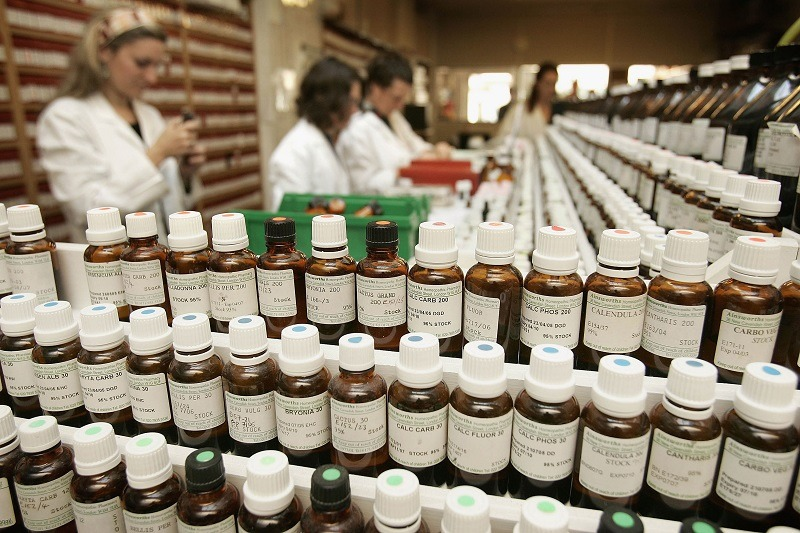 Pharmacy staff making up homeopathic remedies