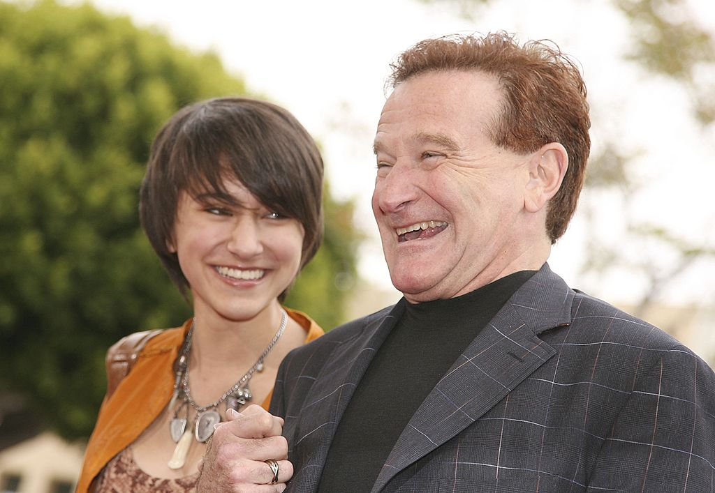 Robin Williams and his daughter Zalda holding hands and laughing