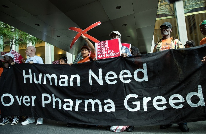 Activists rally during a protest against the price of prescription drugs