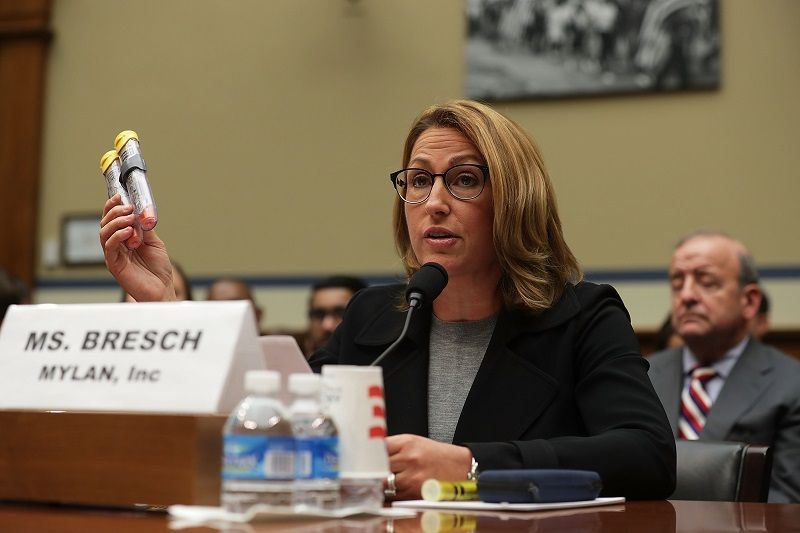 Mylan Inc. CEO Heather Bresch holds up a 2-pack of EpiPen as she testifies during a hearing before the House Oversight and Government Reform Committee