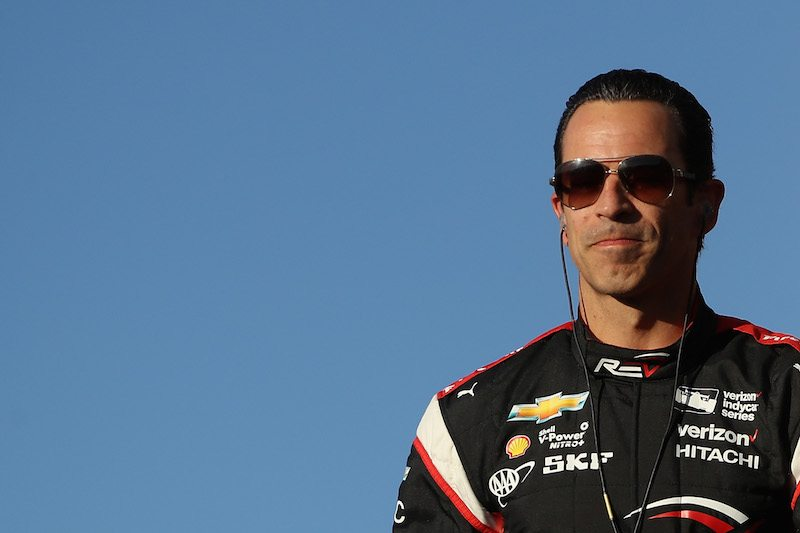 Helio Castroneves of Brazil greets fans as he is introduced to the Desert Diamond West Valley Phoenix Grand Prix