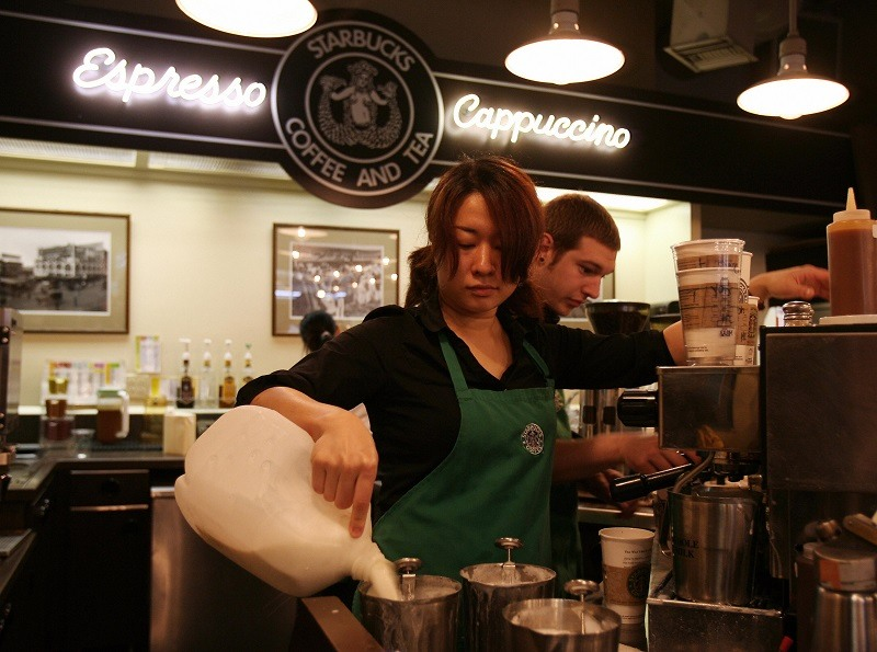Starbucks employees, many of which could benefit from secure scheduling laws