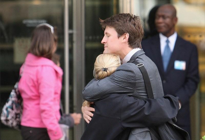 Employees hug